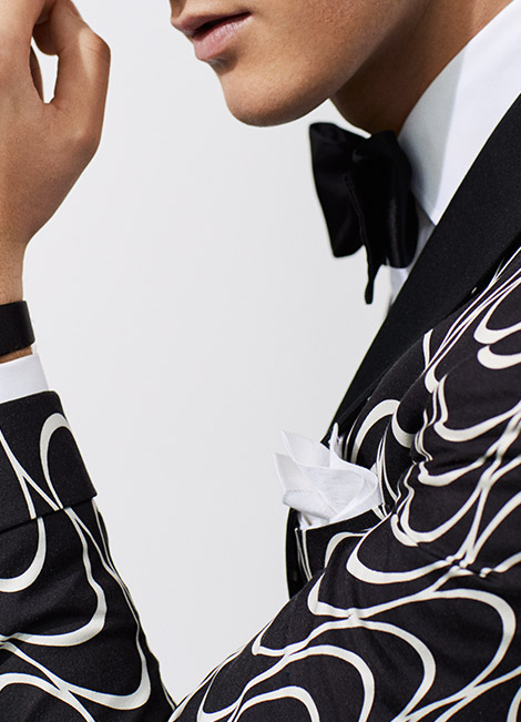 Man in black-and-white dinner jacket with Art Deco print