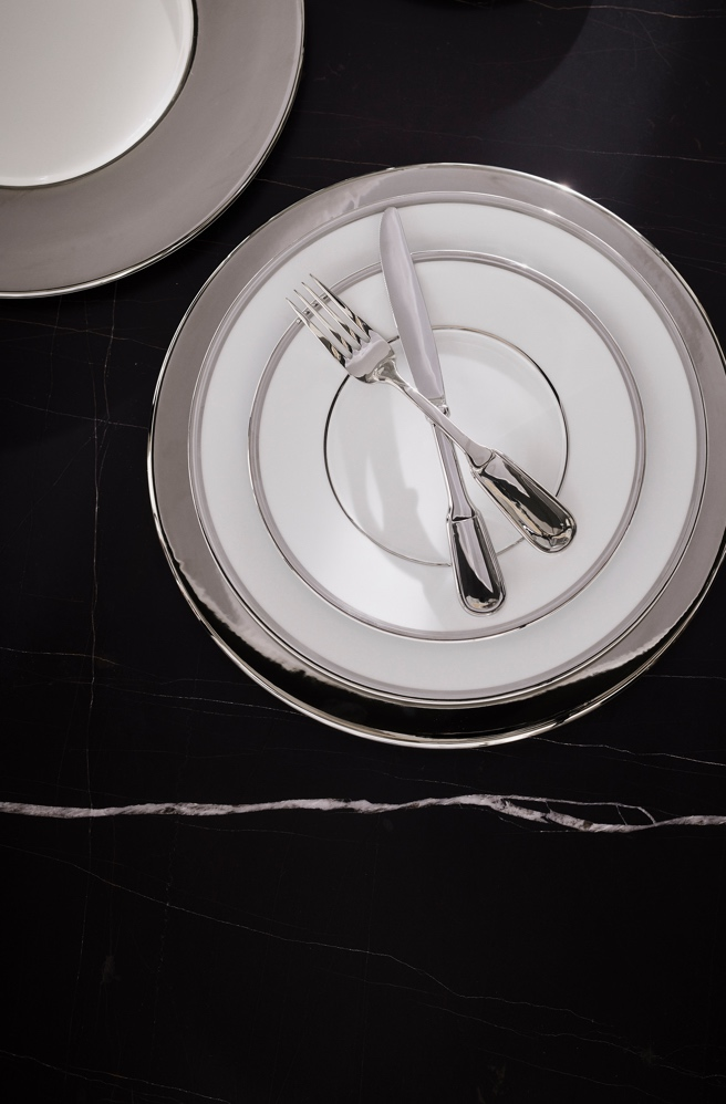 White porcelain plates with painted silver bands