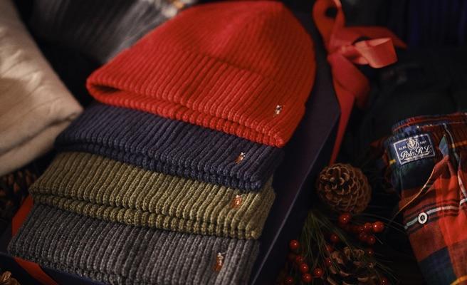 Rib-knit hats in red, navy, olive green & grey hues.
