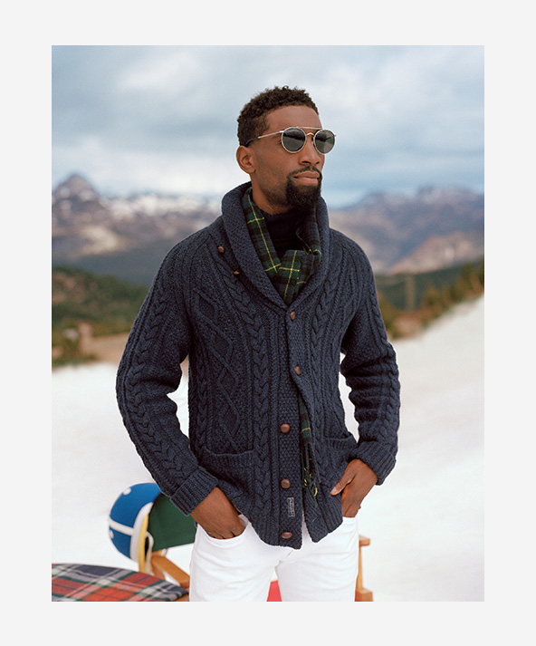 Man in blue-grey Aran-knit shawl cardigan with wooden buttons