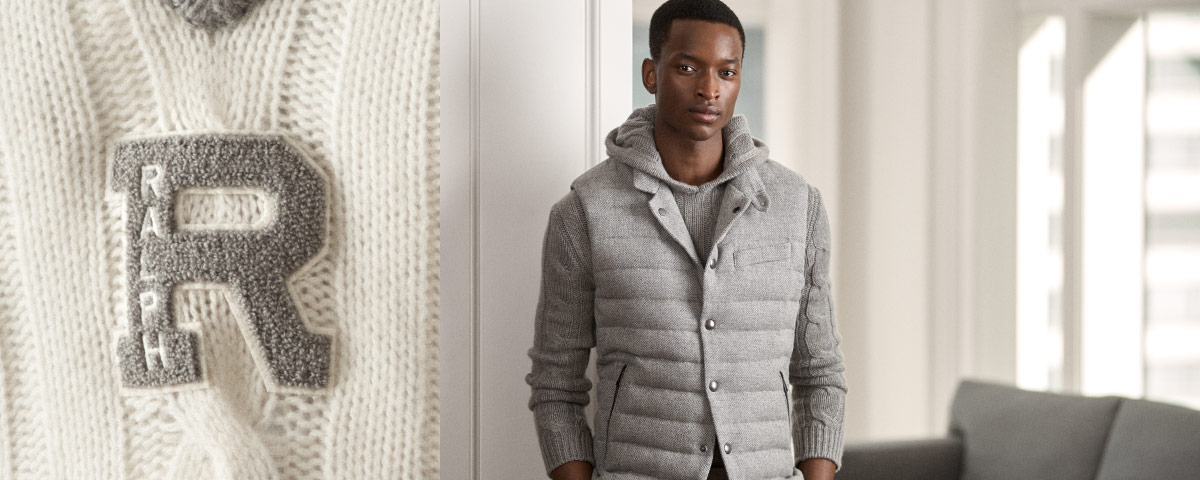 """Close-up of white sweater with grey """"R"""" patch; man in quilted vest over hooded sweater."""
