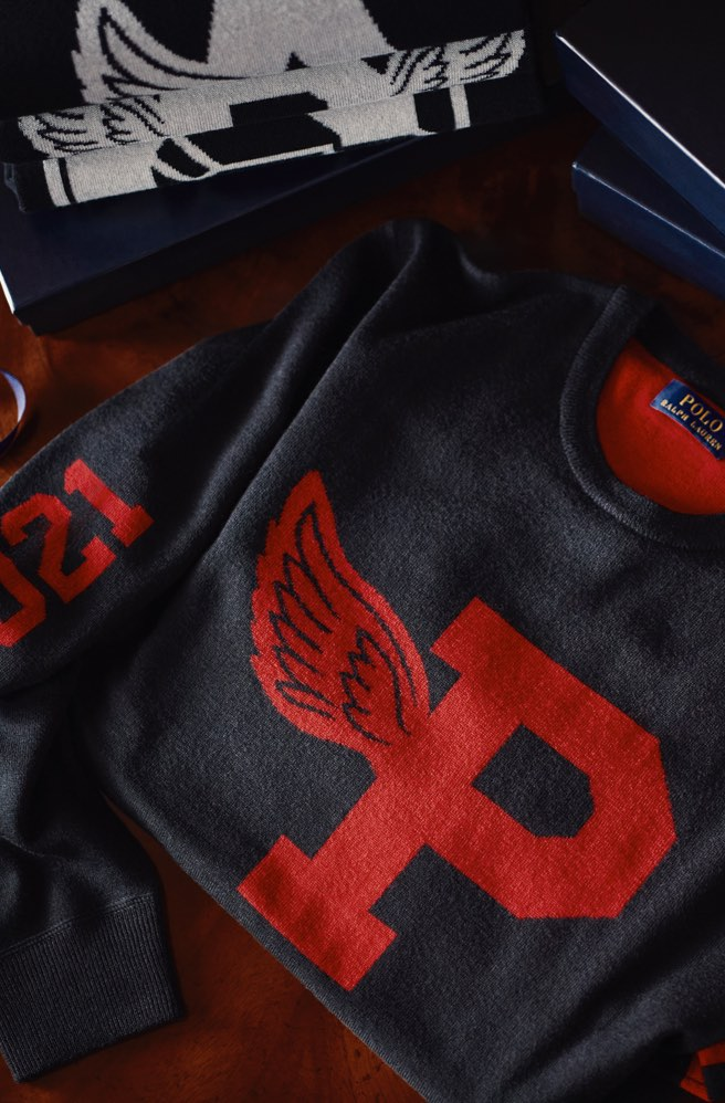 Navy sweater customized with large red P-wing graphic.