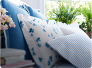Pillows with shams featuring stirpes & floral prints in blue hues