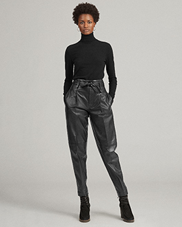 Woman wears black leather paperbag pant