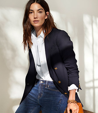 Woman in navy blazer, white shirt & jeans