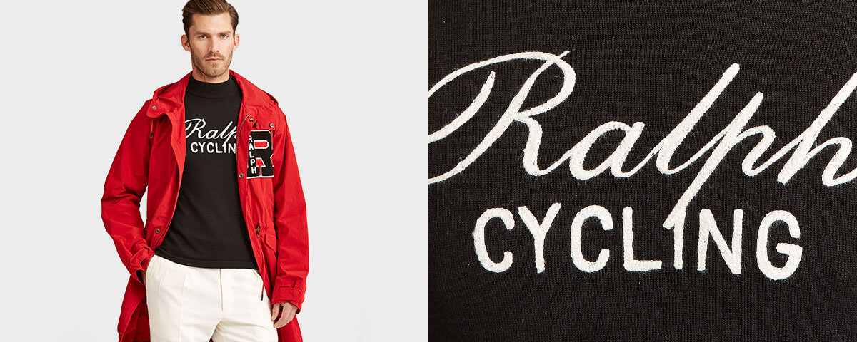 Model in red parka layered over knit black Ralph Cycling top