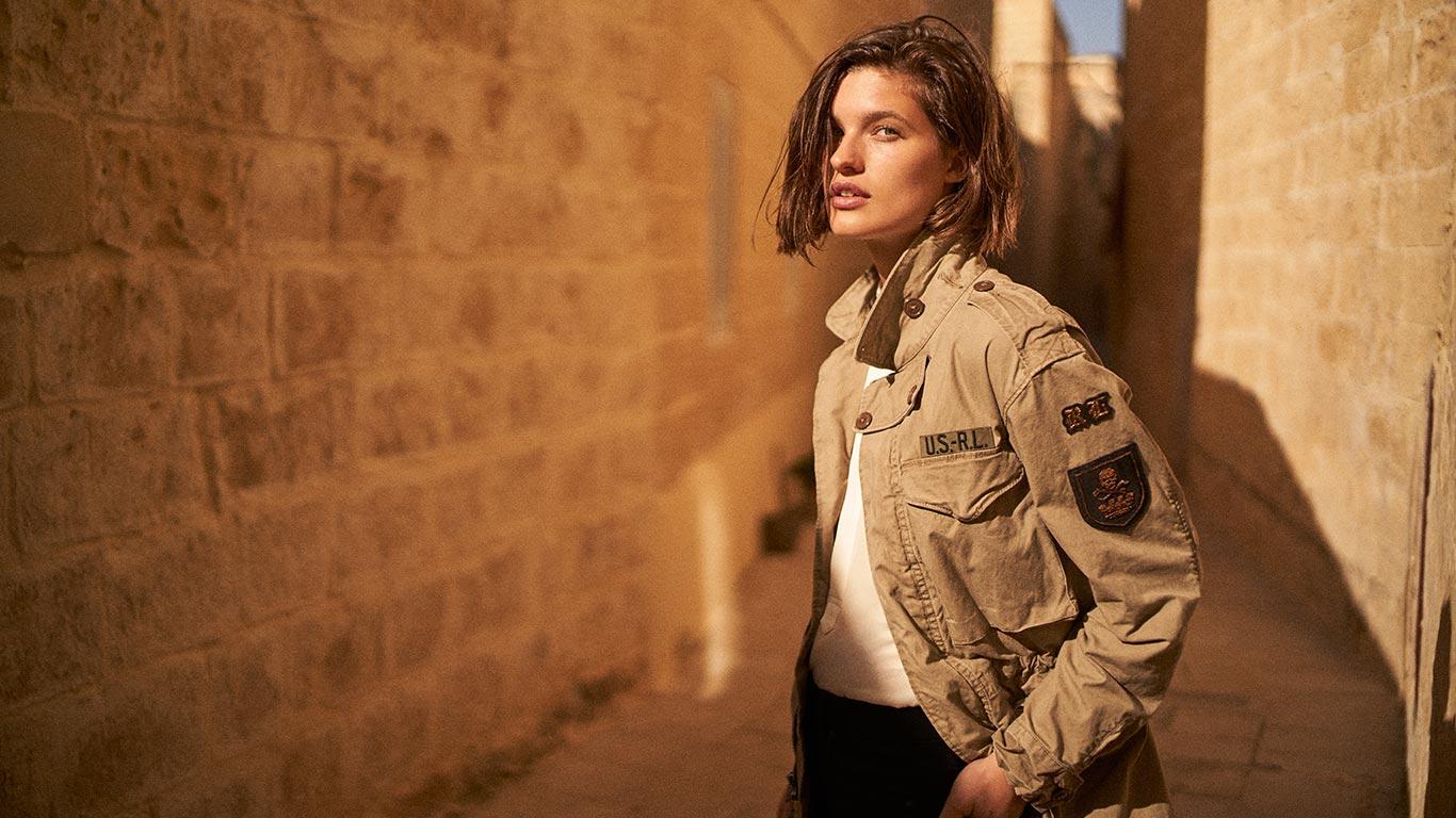 Woman in tan military jacket
