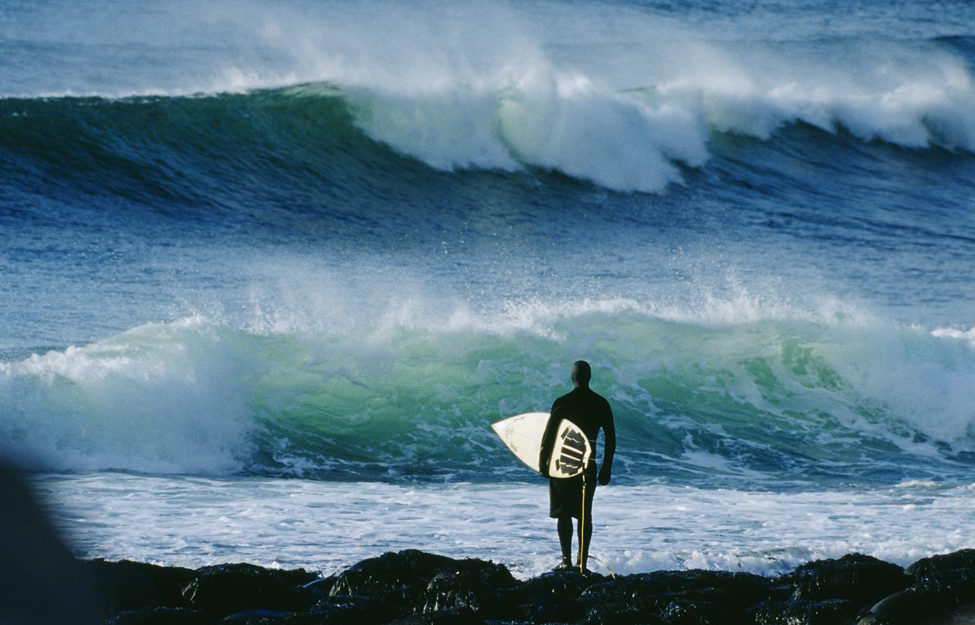 "A surfer observes the waves at Unstad. ""There are these huge mountains that come straight out of the ocean,"" another surfer says. ""You forget that you're even going surfing"""