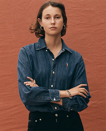 Woman in denim button-down with multicolored pony at front
