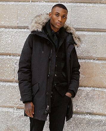 Man in faux-fur-trimmed black parka