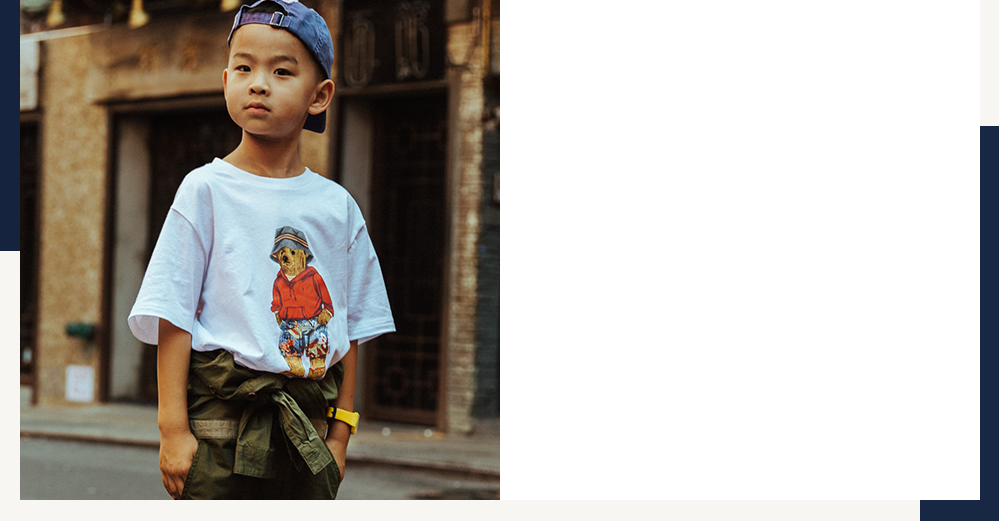 Boy wears Palm Springs Polo Bear tee and backwards cap.