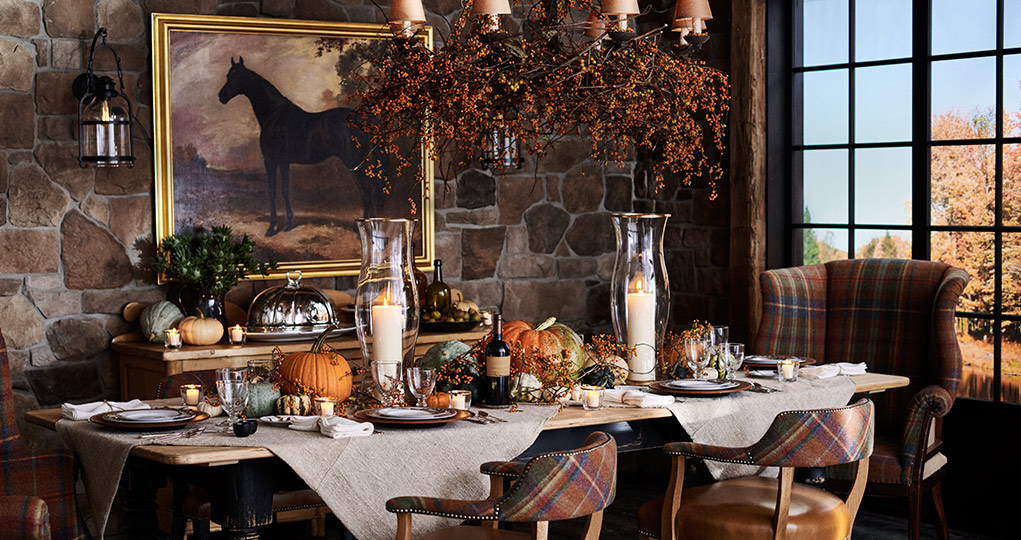 Dining table with plaid-accented seating & pumpkin centerpieces