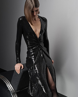 Black sequin wrap dress with deep V-neck and side slit