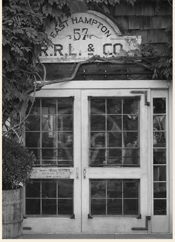 Greyscale photograph of Double RL storefront