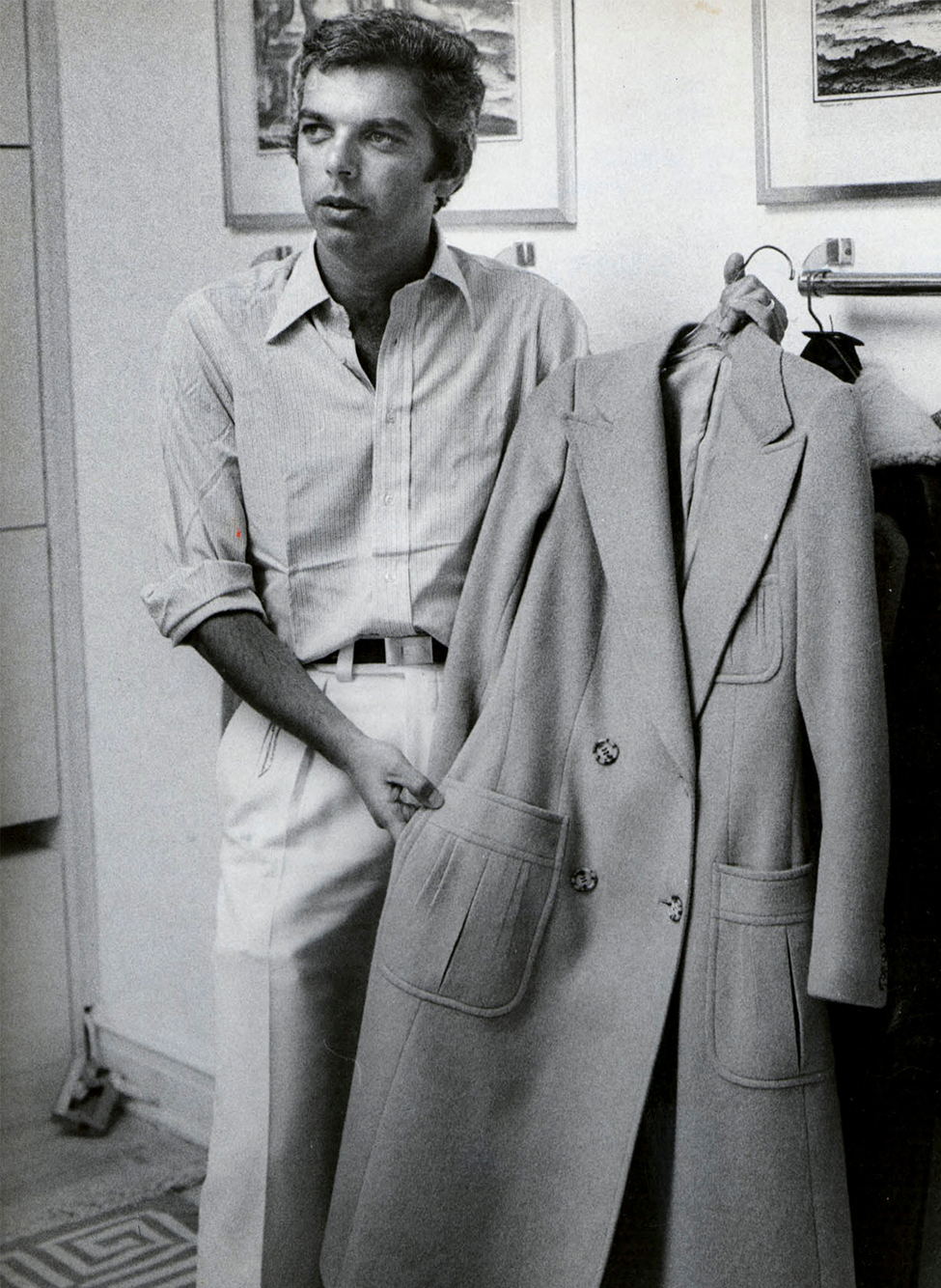 Ralph Lauren in the '70s with his iconic polo coat, which was to become one of the brand's signature classics
