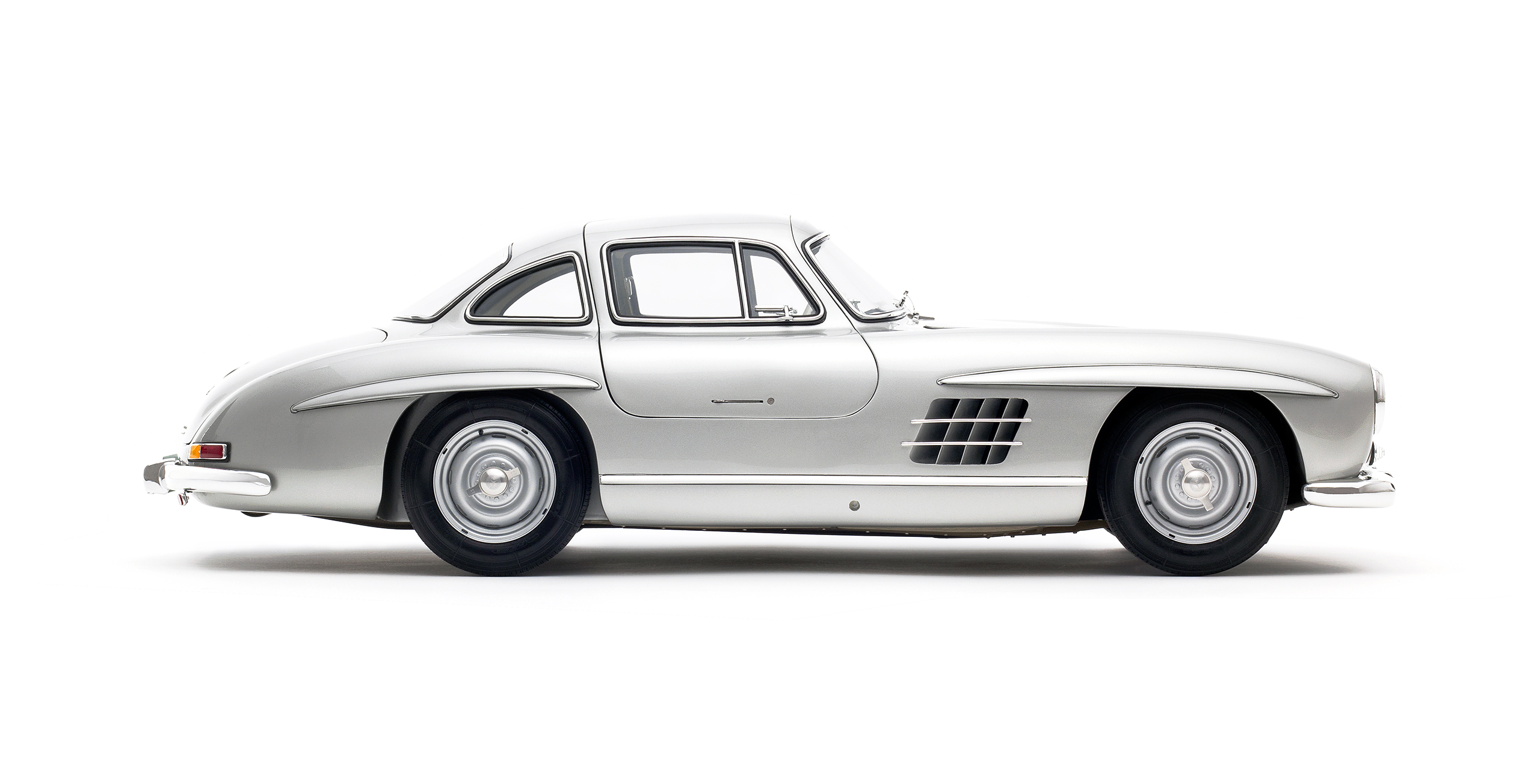 "The 1955 Mercedes Benz 300 SL Coupe ""Gullwing"" was the fastest production car of its time, the first to use fuel injection directly into the cylinders for a top speed of 161 miles per hour"