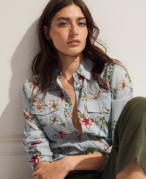 Woman in light blue floral button-down