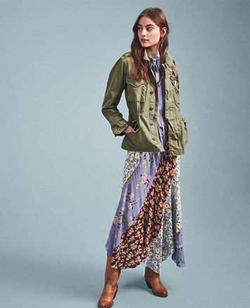 Woman in patchwork floral dress & military jacket