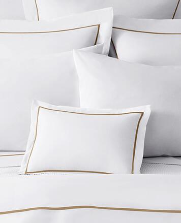 White bedding with thin brown stripe trim