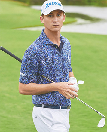 Golf player on green in Polo shirt with abstract leaf print