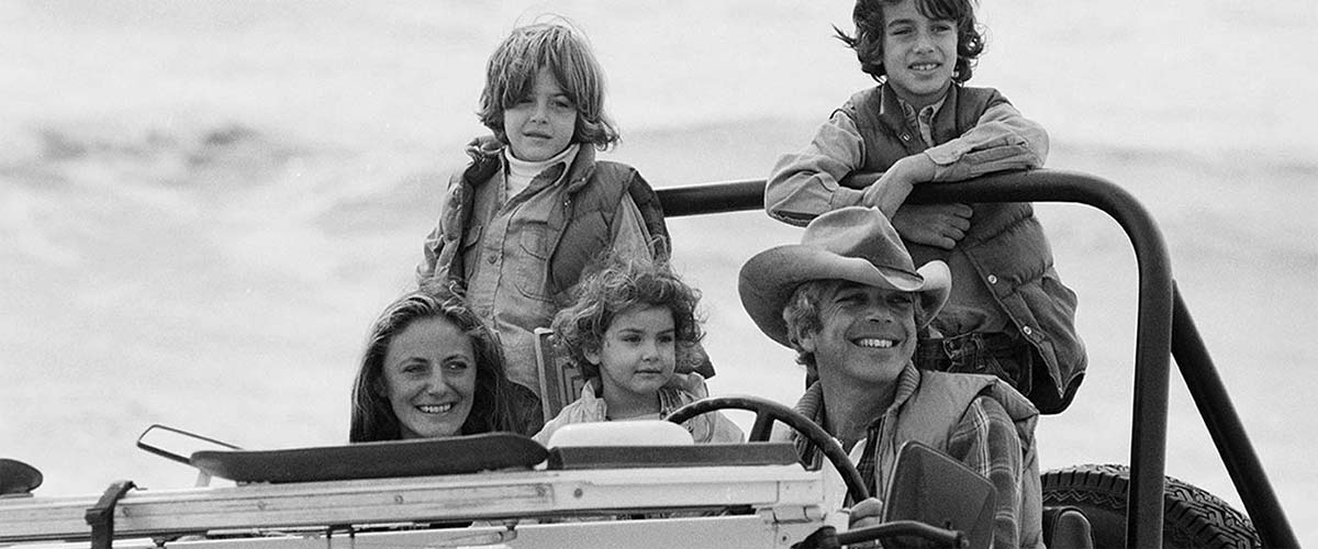 Black-and-white photo of Lauren family in Jeep.