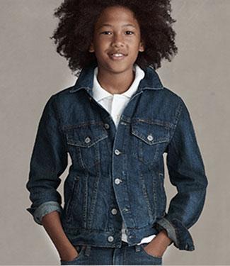 Model wears customized denim jacket.