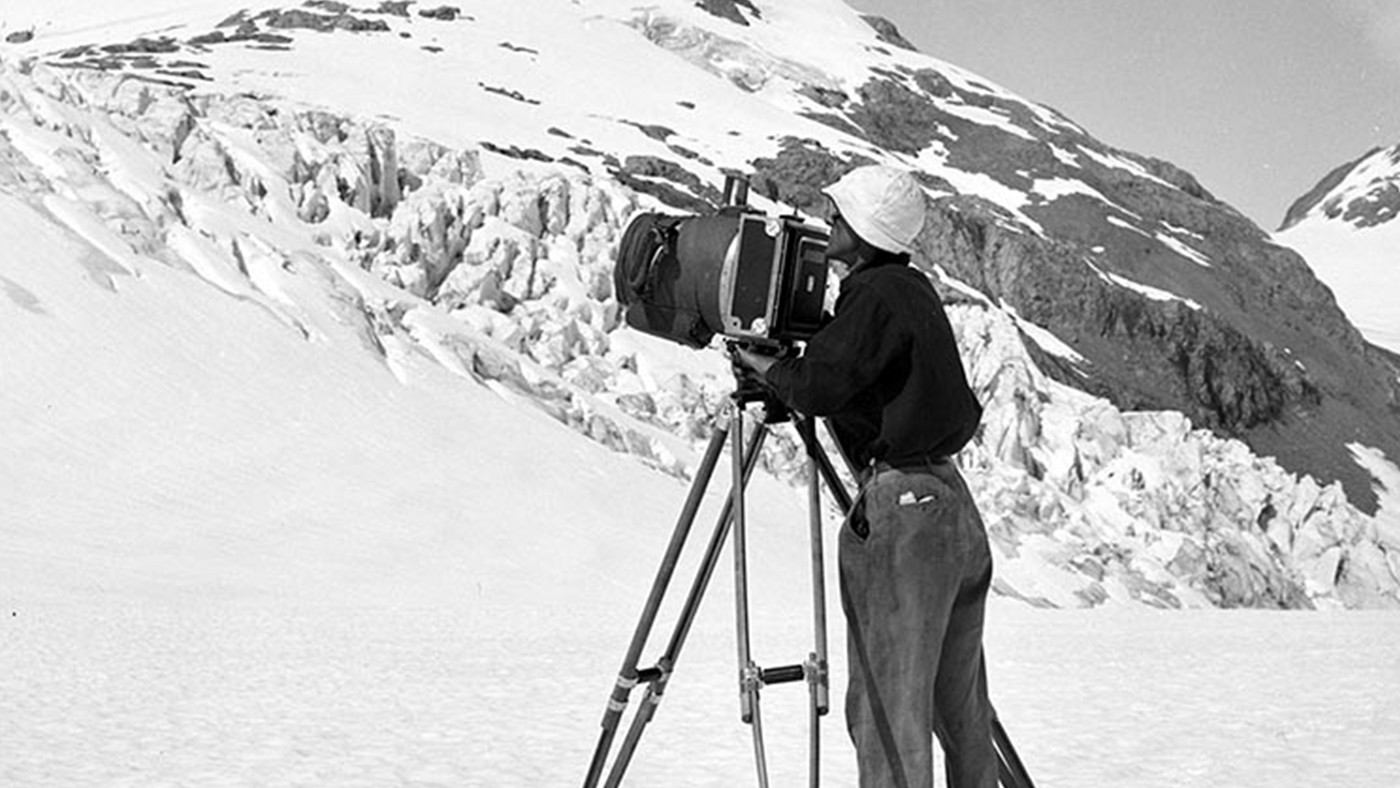 Washburn with his camera during an expedition to Mt. Bertha, Alaska (1940)