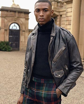 Man in leather jacket & tartan pants