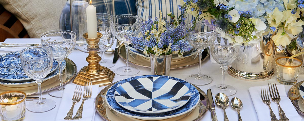 Table set with plates featuring painterly blue designs