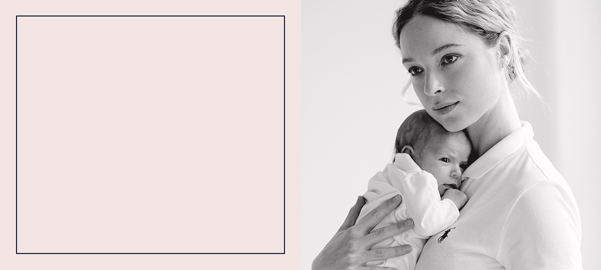 Black & white image of mom holding newborn