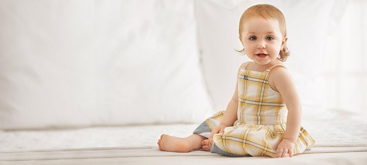 1c981d77efc Baby girl wears yellow plaid dress.