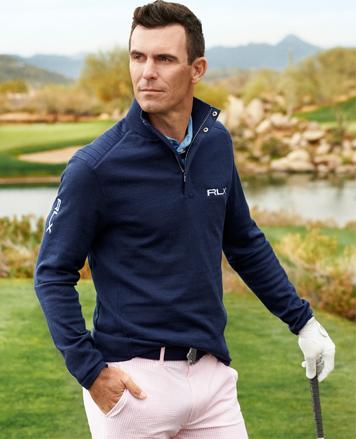 Man in navy RLX half-zip pullover
