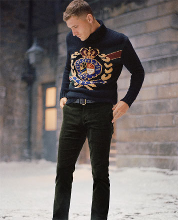 Navy turtleneck sweater with large crest motif at front