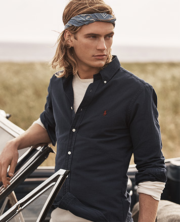 Model in navy button-down shirt & bandanna wrapped around head