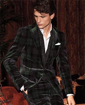 Man wears plaid velvet suit.