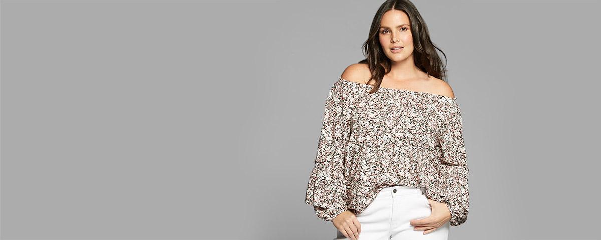 Plus-size model in floral off-the-shoulder top