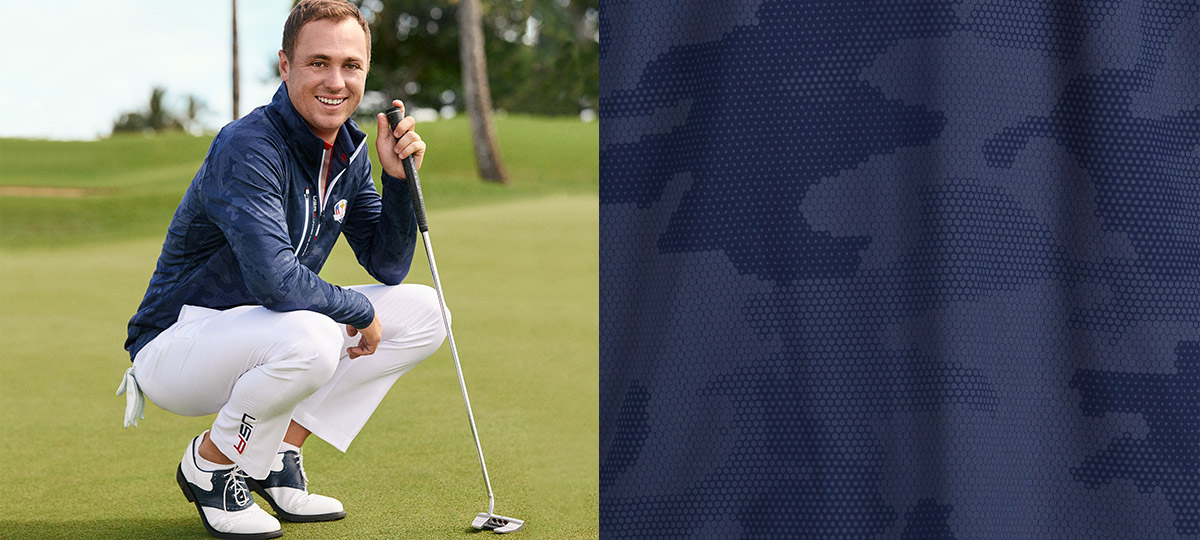 Image of Justin Thomas in white pants & navy pullover