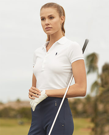 Woman in trim white Polo shirt with embroidered pony