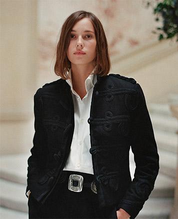 Woman in blazer with soutache loop closures