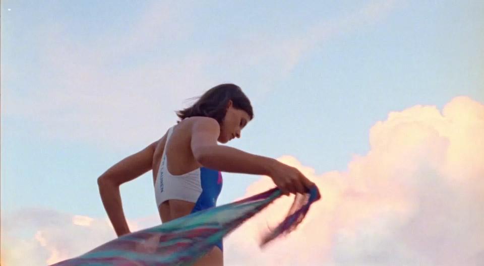 Video of woman in plaid beach wrap