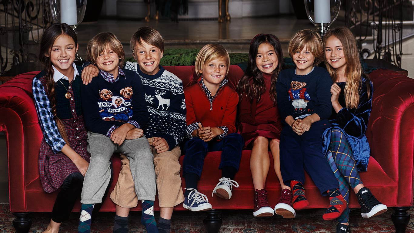 Kids in festive sweaters featuring Polo Bear & snowflake motifs