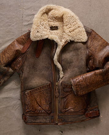 Shearling-lined weathered brown leather jacket