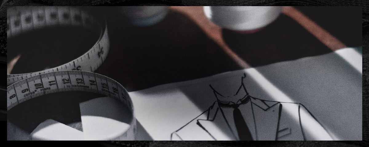 Close-up image of tape measure & suit design sketch