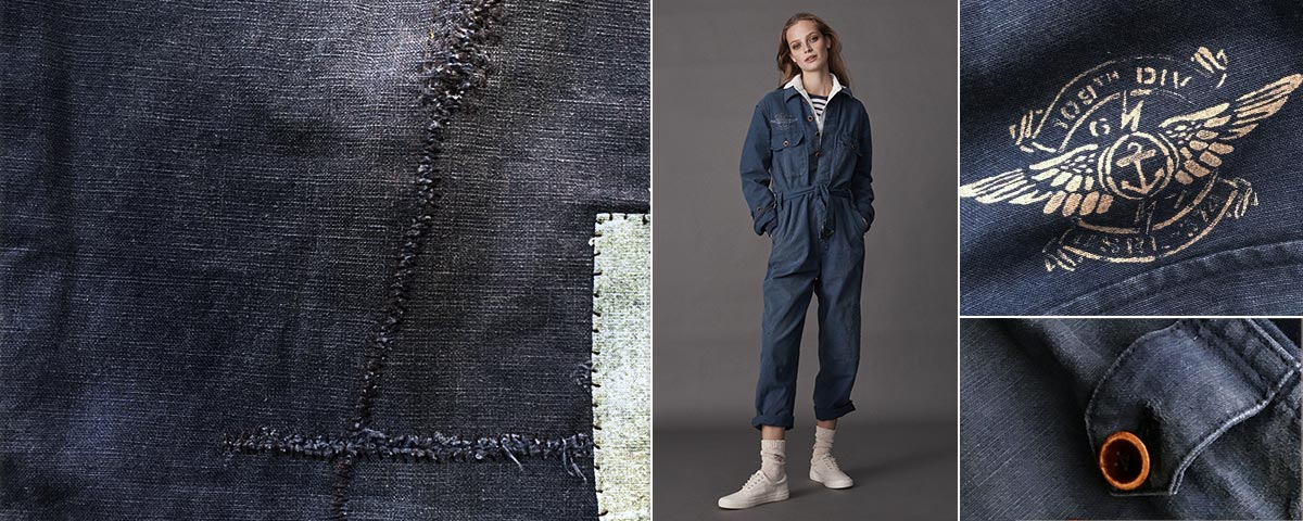 Woman in indigo jumpsuit worn with white sneakers & striped shirt