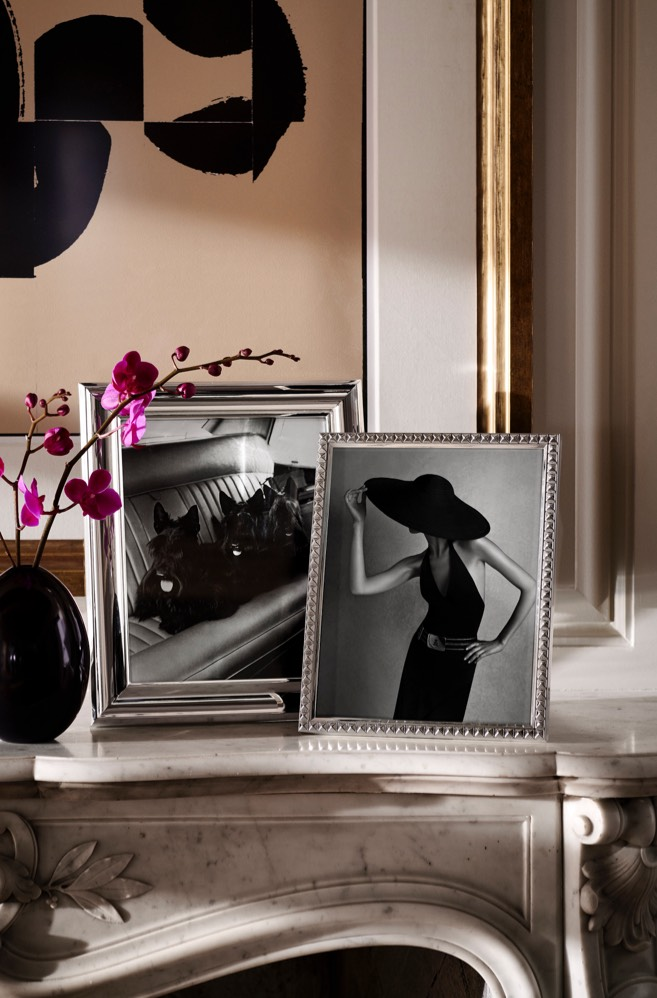 Silver-plated rectangular picture frames on mantel