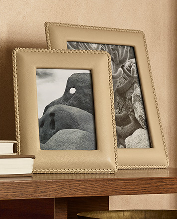 Tan leather pictures frames with stitched borders