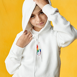 Josie Totah in white hoodie with small rainbow Polo Pony graphic
