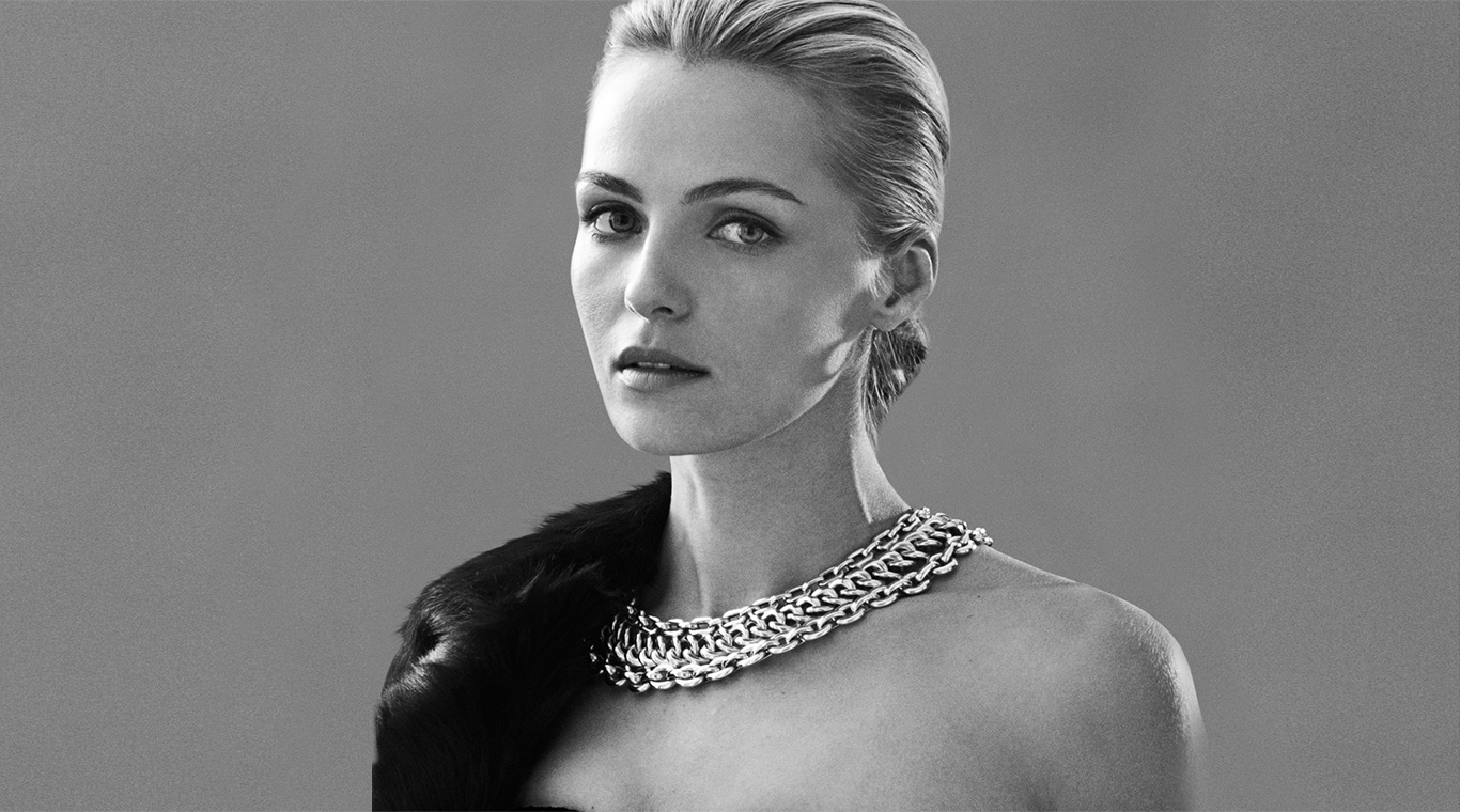 Woman modeling necklace with a dramatic collarlike effect