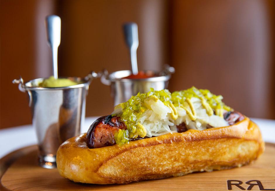 Polo Bar hot dog on wooden board.