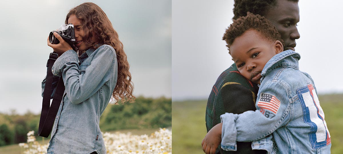 Girl in denim shirt holds camera; boy in jean jacket rests on dad's shoulder.